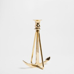 Add some shine to the room with this funky brass candle holder. £29.99